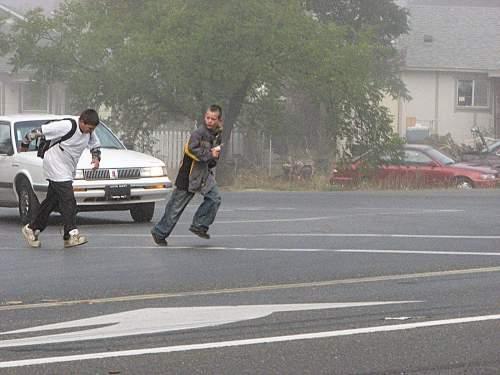 Schoolkids running across Hwy 20